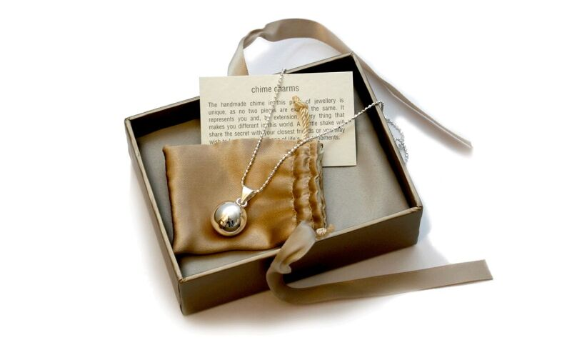 Chiming Ball Necklace Contents
